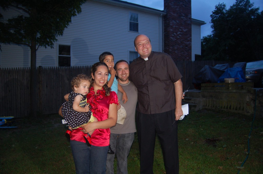 Sermed, Aseel and Family with Fr. Mike