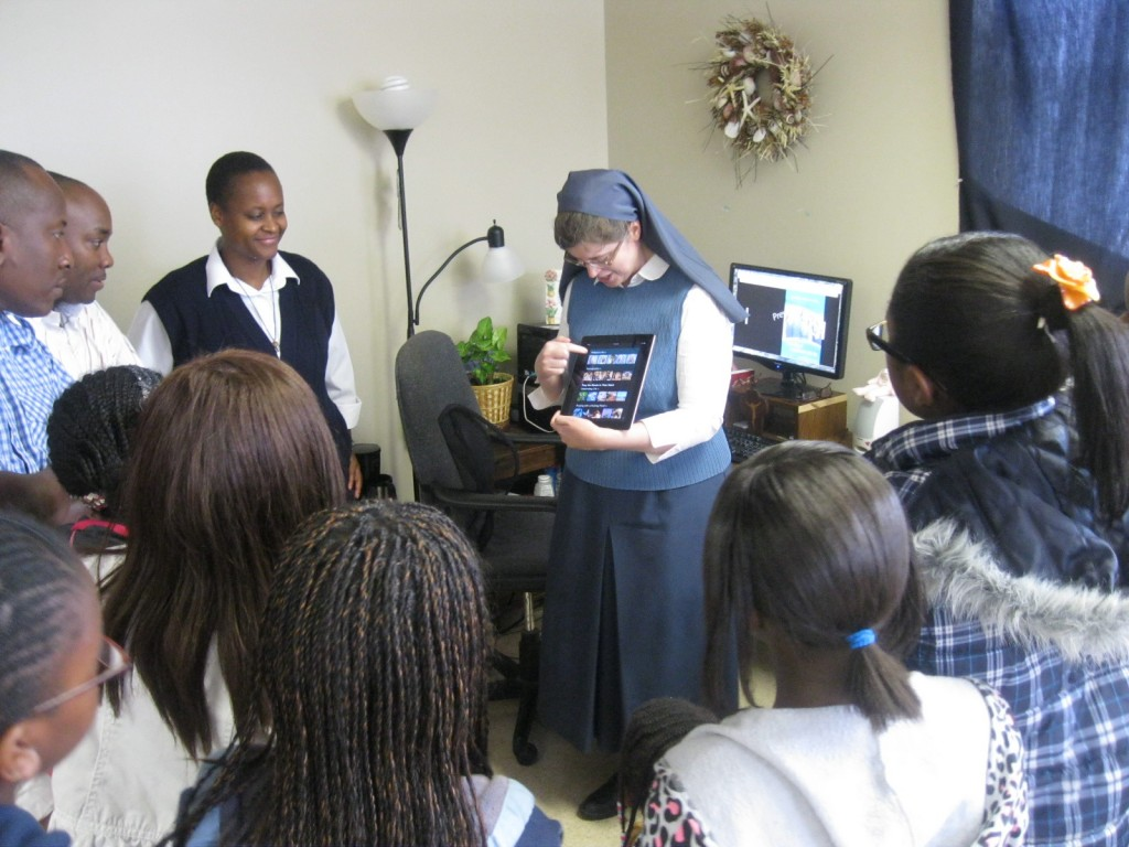 Sr. Kathryn James Hermes, FSP shows the youth some of the Apps produced by the Daughters