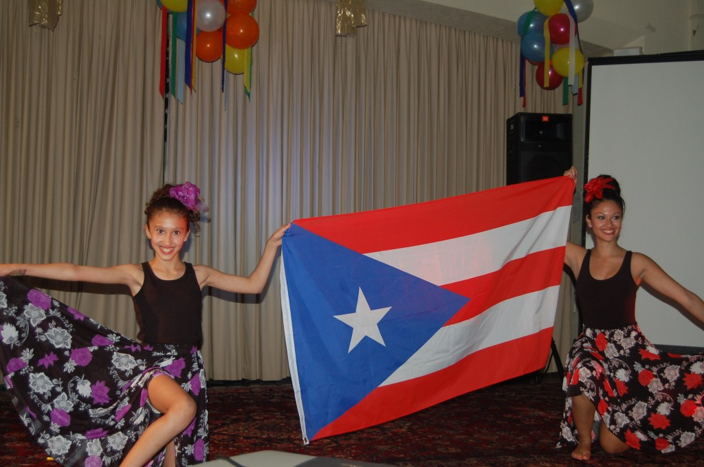 Arielys and Jennifer Ruiz proudly bearing the Puerto Rican flag