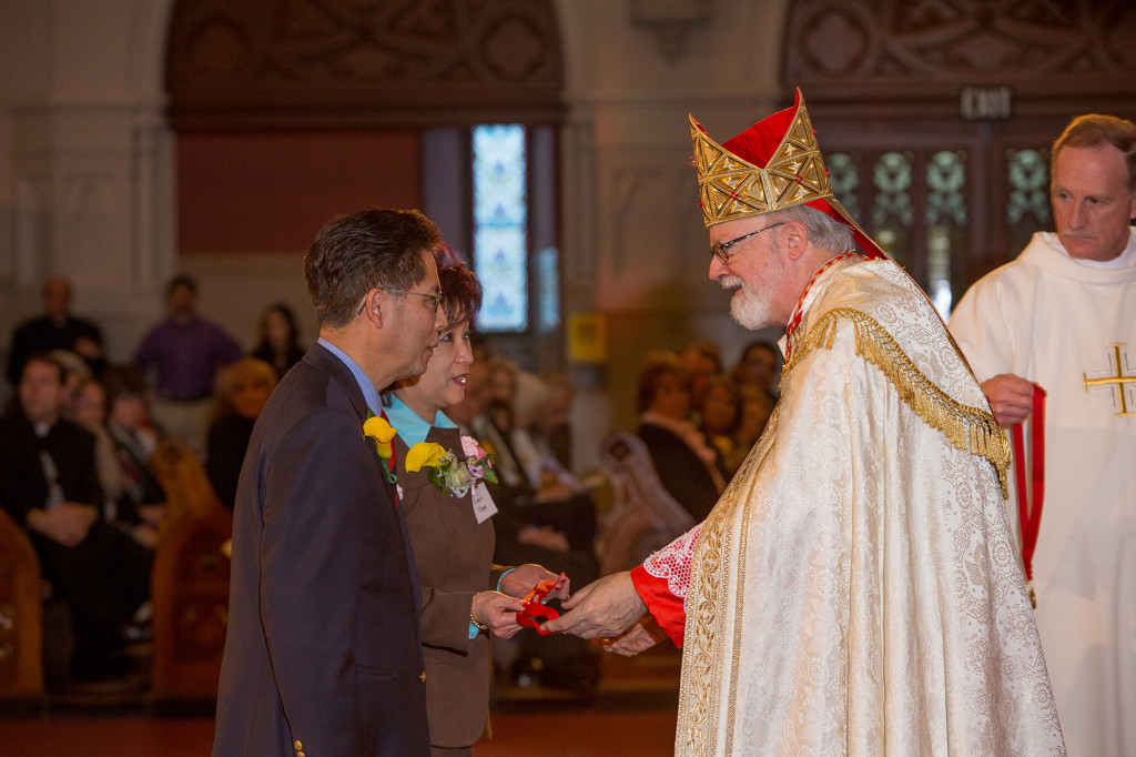 Peter and Laura Chan receive the Cheverus award from Cardinal Sean