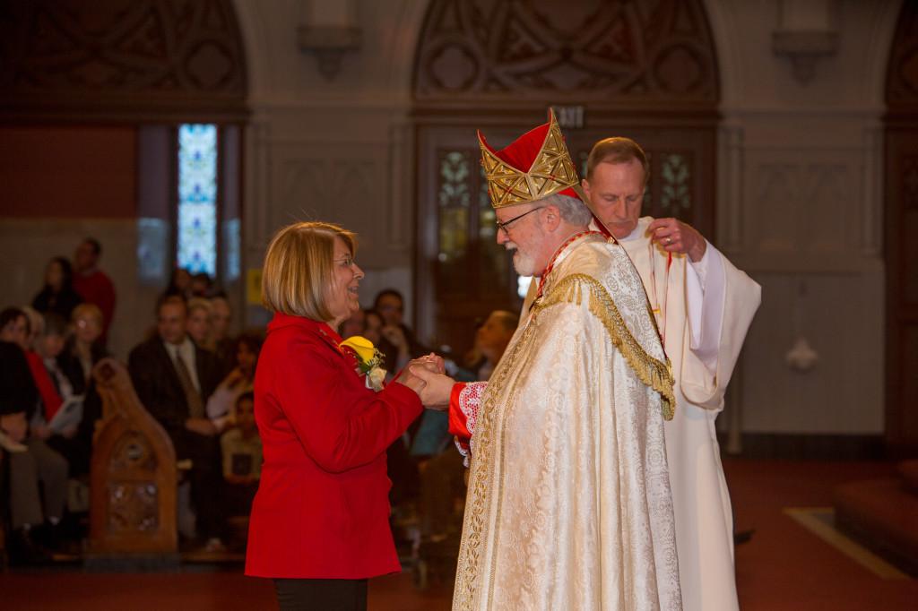 Herondina Ferreira receives the Cheverus award from Cardinal Sean