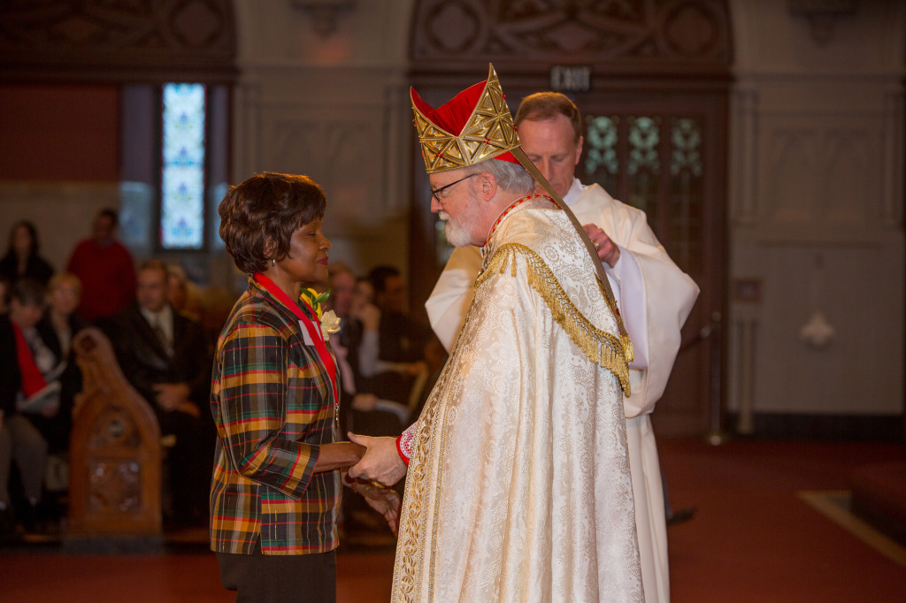 Joyce Durst receives the Cheverus Award from Cardinal Sean
