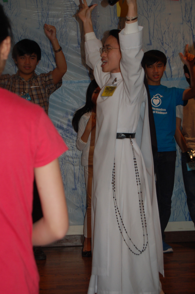 Sr. Christine getting young people singing