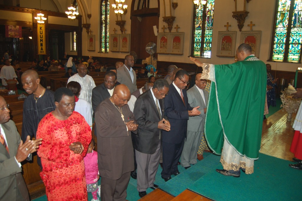 Fr. Jude Osunkwo blessing the men of the community