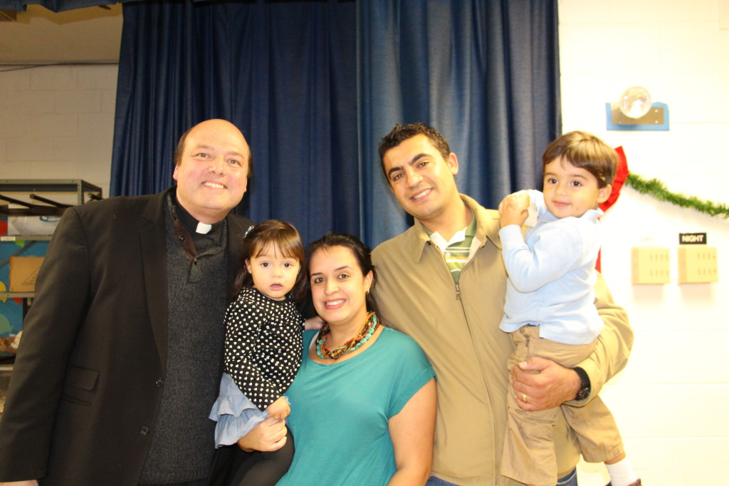 Thiago and Carla Otoni and their children Davi, Bianca and Baby girl to be born Beatriz with Fr. Michael