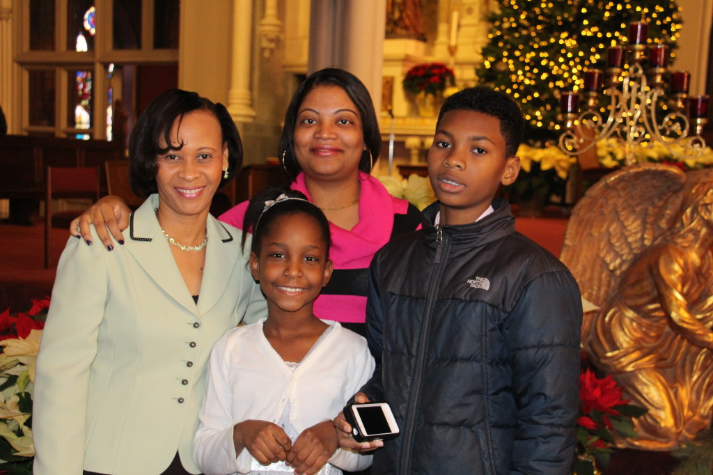 Mary Lourdes Daceus with her family members (Cassandre, Michaelle, and Joseph)of St. John's in Cambridge