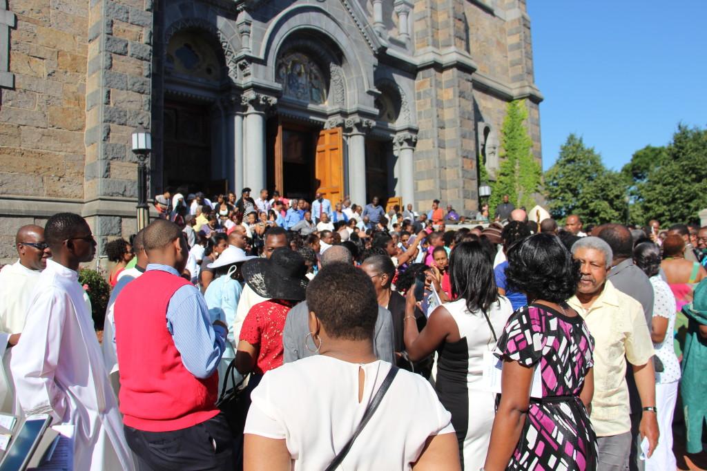 Crowd of people surrounding Cardinal Langlois.